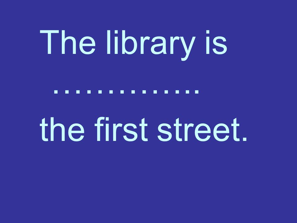 The library is ………….. the first street.