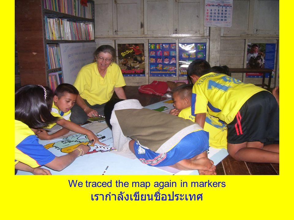 We traced the map again in markers เรากำลังเขียนชื่อประเทศ